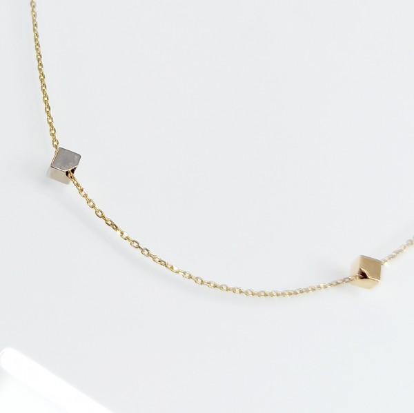 Arany nyaklánc kocka rátétekkel